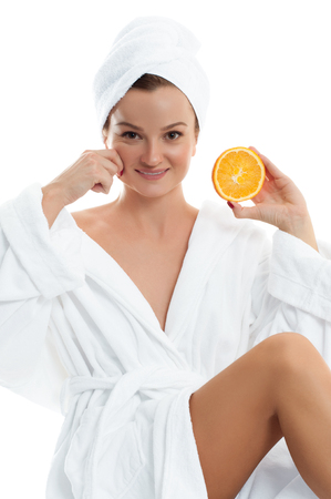 Beautiful young woman with clean fresh skin. Facial treatment. Cosmetology, beauty and spa .