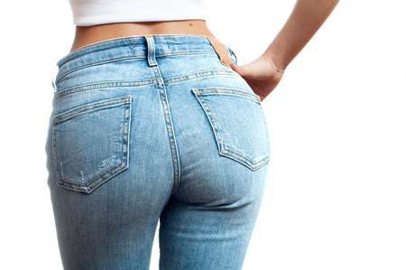 Woman wearing of jean pants from back. Female bottom in tight jeans Foto de archivo