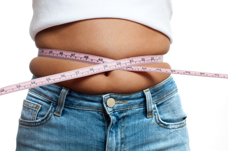 Overweight woman with tape measure around waist. Woman belly fat overweight Foto de archivo