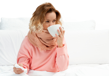 Woman having a cold, flu. Sore throat, coughing and fever Stock Photo