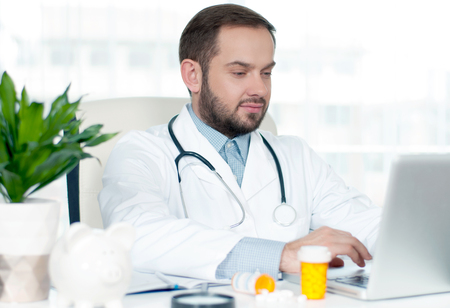 Doctor concept. Doctor sitting at the desk in hospital