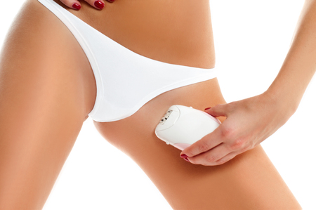 Epilation Concepts. Women health and intimate hygiene. Beautiful Womans body with smooth soft skin in white bikini panties.  Stock Photo