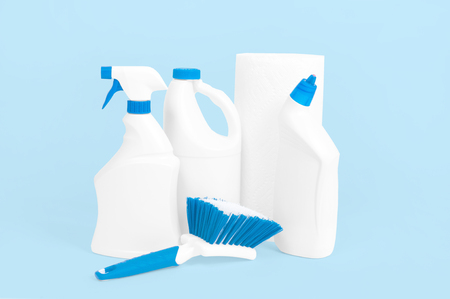 Plastic bottles with washing detergent for toilet on pastel blue background