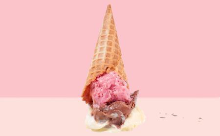 Ice cream on the ground. Chocolate, vanilla and strawberry ice cream cone dropped on floor