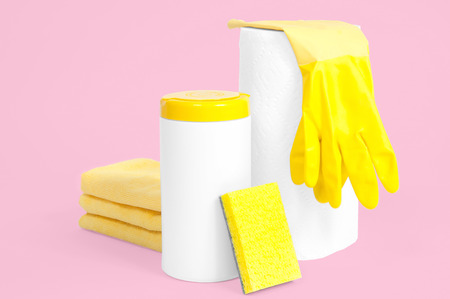 Cleaning supplies on pastel pink background