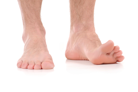 Man Feet itching. infection of the feet caused by fungus.
