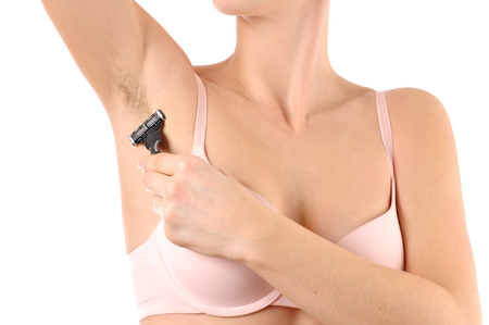 Woman shaving razor armpit on white background. Depilation, hair removal and skin care concept.