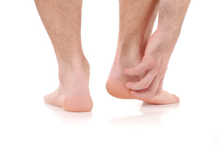 Man scratch the itch with hand. Foot itching, infection of the feet caused by fungus.