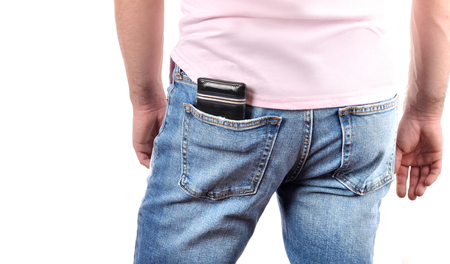 Man put wallet in back pocket of his jeans 免版税图像