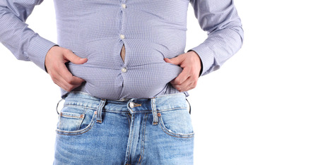 Man with overweight and big fat belly in jeans and shirt Banco de Imagens