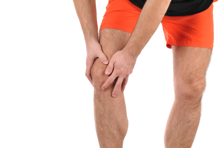 Man holds on to knee, pain in knee Stock fotó