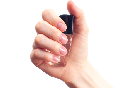 Beautiful woman's hand with transparent nail polish . Spa and manicure. Soft skin, the concept of nail care.
