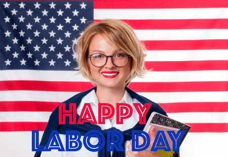 Happy Labor Day. USA flag and happy student woman.