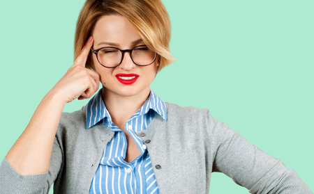 Beautiful business woman thinking of her plans on green background. Ideas or dreams Banco de Imagens