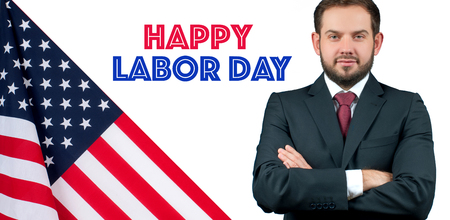 Happy Labor Day. USA flag. Business man in suit standing with crossed arms