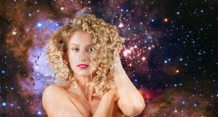 Leo Zodiac Sign on night sky background. Beautiful woman with wavy hair.