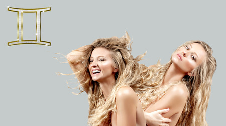 Gemini Zodiac Sign. Astrology and horoscope concept, two beautiful women with curly long hair