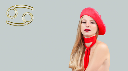Cancer Zodiac Sign. Astrology and horoscope concept, beautiful woman in red beret with long hair
