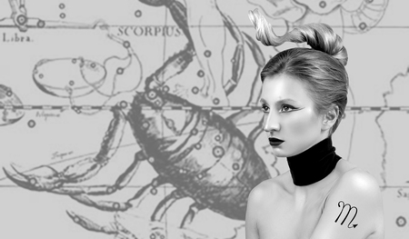 Scorpio Zodiac Sign. Astrology and horoscope concept. Beautiful woman Scorpio on zodiac map Stock Photo