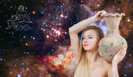 Aquarius Zodiac Sign. Astrology and horoscope concept. Beautiful woman Aquarius on the galaxy background Zdjęcie Seryjne