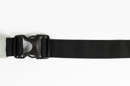 Waist bag, buckle from plastic with black belt on the white background