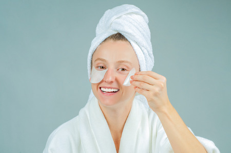 Face care and beauty treatments. Beautiful woman with cosmetic patches under eyes Standard-Bild
