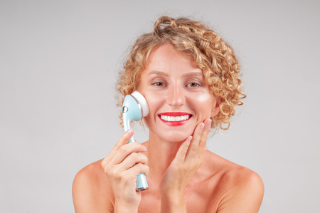 Facial care. Perfect fresh clean skin concept. Beautiful woman washing her face