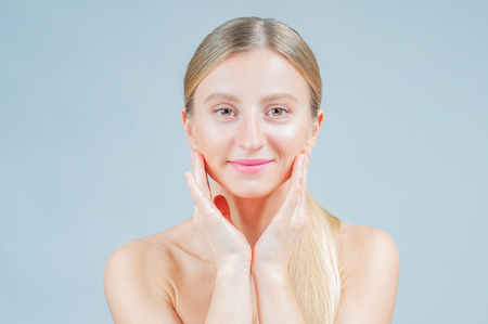 Beauty and facial treatment. Beautiful woman with clean perfect skin touch own face Stock Photo