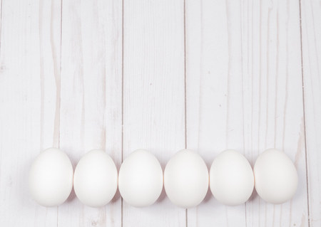 White egg. Raw eggs on white background. Concept happy easter.