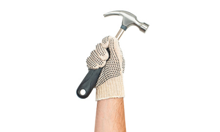 Tool. Hand in glove is holding hammer isolated on a white background .
