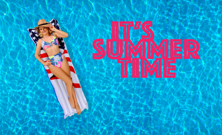Pool background with letters its summer time. Enjoying suntan Woman in bikini on the inflatable mattress in the swimming pool. Stockfoto