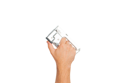 Tool. Hand is holding industrial stapler isolated on a white background . 版權商用圖片