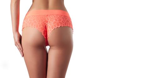 Hautpflege und Anti-Cellulite-Massage. Perfekte Frau ohne Cellulite im Höschen. Der Hintern der schönen Frau in der Unterwäsche. Schlanke Passform Frauenkörper. Standard-Bild