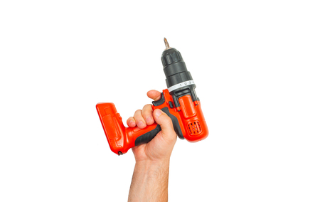 Tool. Hand is holding electric drill isolated on white background. 版權商用圖片