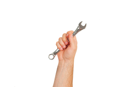 Tool. Hand is holding wrench isolated on white background.