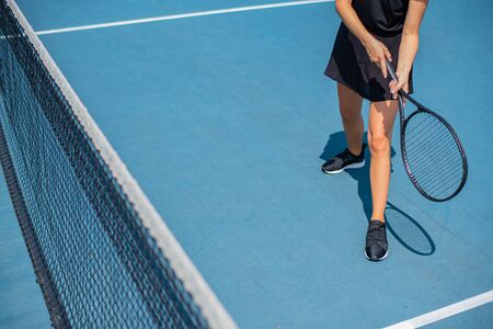 Beautiful sports woman playing tennis on the blue tennis court 스톡 콘텐츠