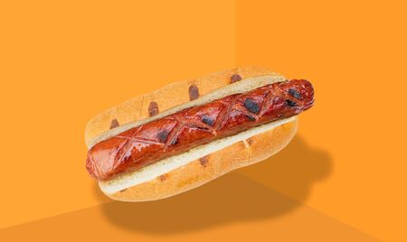 Hot dog with mustard on yellow background. Fried sausage in bread.