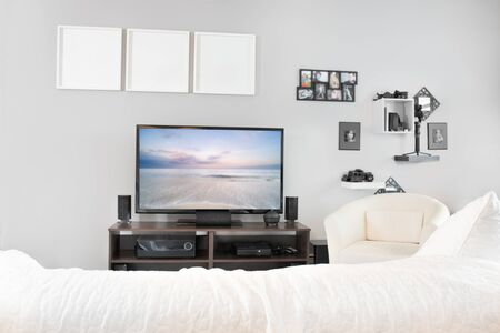 Cozy interior of living room with television on stand. Stockfoto