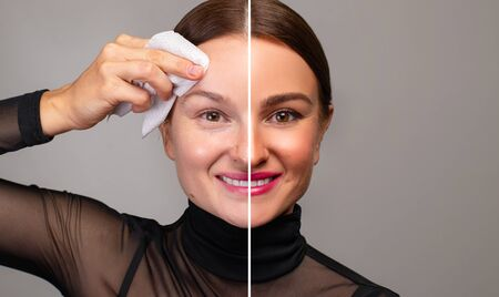 Beautiful woman removing makeup from her face. Skin care and beauty concept