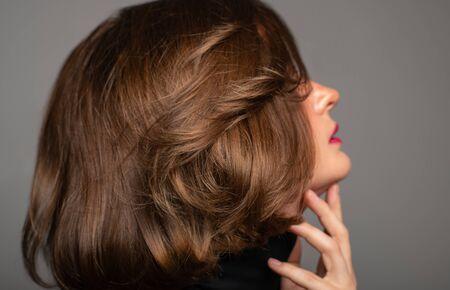 Brunette girl with shiny brown hair. Beautiful woman with bob haircut Banco de Imagens
