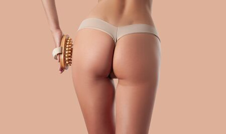 Body care and anti cellulite treatment. Perfect female buttocks without cellulite in underwear. Woman make anti cellulite massage. Archivio Fotografico