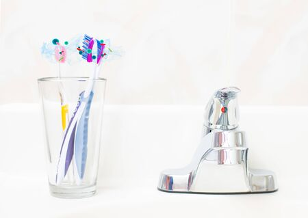 Dental hygiene. Tooth brushes with bacteria in glass in the bathroom