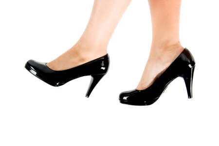 female feet wearing black shoes with high heals