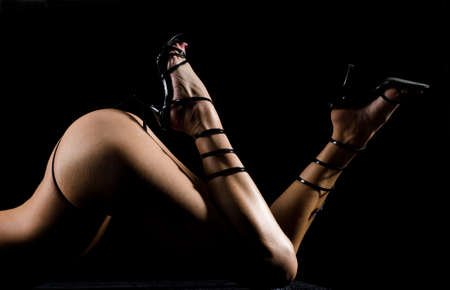 Female body with g-string and shoes with high heels