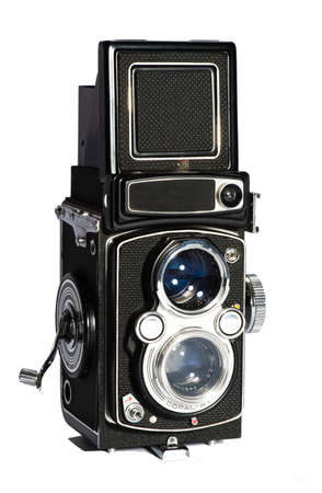 Old doubble obtics camera seen from the front, isolated on white
