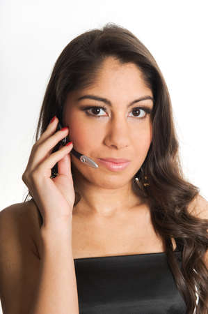 Portrait of a beautiful young woman speaking in the phone, wearing a headset