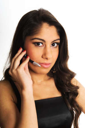 Beautiful young women with headset, ready to take your call Stock Photo