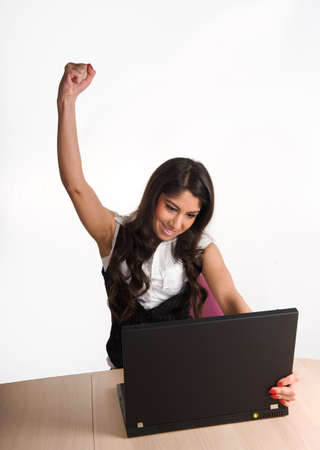 Beautiful girl working on labtop, showing dedication and success Stock Photo