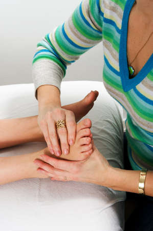 Closeup of teenagers foot during massage treatment at health center Stock Photo - 4166008