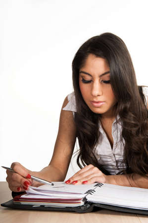 Beautiful girl focused on her planner Stock Photo